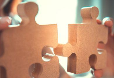 Aus zwei mach eins: Das GWB-Digitalisierungsgesetz erleichtert Zusammenschlüsse im Mittelstand.